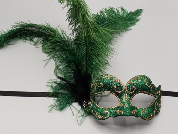 Half glitter mask with green feathers